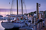 Dawn lights a schooner in Camden Harbor, Camden, ME, USA