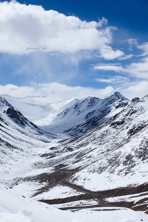Khardung La (5359m) is a High Mountain Pass in Ladakh. It is also allegedly the World's Highest Motorable Road. The 5,359 m elevation given above is from a modern GPS survey by a team of researchers and there are allegations that the 5,602m height claimed by the summit signs are grossly incorrect..*Pre-season Jeep road trip from Delhi to Amritsar, Srinagar, Kargil, Lamayuru, Leh, Khardung La, Tso Moriri and back to Delhi in May 2010. Photo by Suzanne Lee