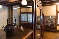 An exhibit at the Japan Folk Crafts Museum (Mingeikan), Tokyo, Japan, September 9, 2012. The museum was founded in 1936 by Soetsu Yanagi (1889-1961). It is dedicated to promoting the Mingei folk crafts movement and showing items from all over Japan. A contemporary and friend of Bernard Leach, Yanagi believed in the high aesthetic value of everyday items made by anonymous craftsmen working in set traditions.