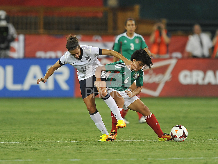 Carli Lloyd (10) of the USWNT goes against Liliana Mercado (6) of Mexico. The USWNT defeated Mexico 7-0 during an international friendly, at RFK Stadium, Tuesday September 3, 2013.