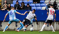 Bolton Wanderers' Dennis Politic (centre) competing with Coventry City's Liam Kelly <br /> <br /> Photographer Andrew Kearns/CameraSport<br /> <br /> The EFL Sky Bet Championship - Bolton Wanderers v Coventry City - Saturday 10th August 2019 - University of Bolton Stadium - Bolton<br /> <br /> World Copyright © 2019 CameraSport. All rights reserved. 43 Linden Ave. Countesthorpe. Leicester. England. LE8 5PG - Tel: +44 (0) 116 277 4147 - admin@camerasport.com - www.camerasport.com