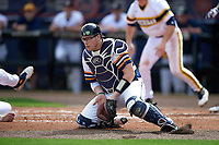 Canisius College Golden Griffins catcher Christ Conley (13) blocks a throw during the first game of a doubleheader against the Michigan Wolverines on February 20, 2016 at Tradition Field in St. Lucie, Florida.  Michigan defeated Canisius 6-2.  (Mike Janes/Four Seam Images)
