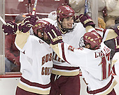 Tim Filangieri, Brian Boyle and Chris Collins celebrate - The Boston College Eagles completed a shutout sweep of the University of Vermont Catamounts on Saturday, January 21, 2006 by defeating Vermont 3-0 at Conte Forum in Chestnut Hill, MA.