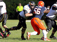 Maryland Terrapins offensive linesman Bennett Fulper (63) blocks Virginia Cavaliers defensive tackle Chris Brathwaite (56) during the game at Scott Stadium in Charlottesville, VA. Maryland defeated Virginia 27-20.