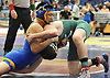 Mike Choi of East Meadow, left, battles Matt Schwartz of Bellmore JFK at 152 pounds during the Nassau County Division 1 wrestling quarterfinals at Hofstra University on Saturday, Feb. 13, 2016. Choi won the match by decision 4-2.