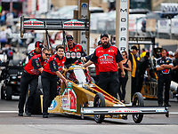 Jul 23, 2017; Morrison, CO, USA; Crew members push the car of NHRA top fuel driver Leah Pritchett during the Mile High Nationals at Bandimere Speedway. Mandatory Credit: Mark J. Rebilas-USA TODAY Sports