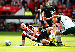 Billy Sharp of Sheffield Utd brought down by Joe Williams of Barnsley during the Championship League match at Bramall Lane Stadium, Sheffield. Picture date 19th August 2017. Picture credit should read: Simon Bellis/Sportimage