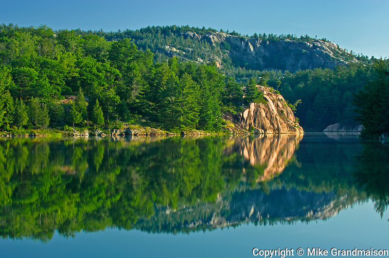 Sunrise reflection on George Lake<br /> Killarney Provincial Park<br /> Ontario<br /> Canada