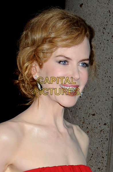 NICOLE KIDMAN .Attending the 57th Annual BMI Country Awards held at BMI Music Row Headquarters, Nashville, Tennessee, USA, 10th November 2009..arrivals portrait headshot strapless pale skin hair up wavy earrings red smiling mouth open profile .CAP/ADM/LF.©Laura Farr/AdMedia/Capital Pictures.