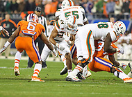 Charlotte, NC - December 2, 2017: Miami Hurricanes running back Travis Homer (24) runs the ball during the ACC championship game between Miami and Clemson at Bank of America Stadium in Charlotte, NC.  (Photo by Elliott Brown/Media Images International) Clemson defeated Miami 38-3 for their third consecutive championship title.