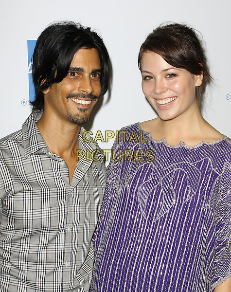 FRANCIS TEN & MELISSA BALDWIN. 27th Annual Macy's Passport Fashion Show Benefit - Arrivals held At Barker Hangar, Santa Monica, California, USA..September 24th, 2009.half length tan grey gray shirt purple goatee facial hair silver pattern .CAP/ADM/KB.©Kevan Brooks/AdMedia/Capital Pictures.