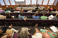 NWA Democrat-Gazette/J.T. WAMPLER Around 40 people attend a public hearing Monday Aug. 10, 2015 to learn about a conversion charter to start a virtual school in 2016-17. The virtual school would provide an alternative to a traditional school.