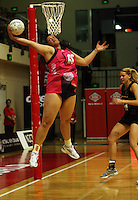World 7 goalshoot Catherine Latu takes a pass during the International  Netball Series match between the NZ Silver Ferns and World 7 at TSB Bank Arena, Wellington, New Zealand on Monday, 24 August 2009. Photo: Dave Lintott / lintottphoto.co.nz