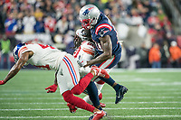 FOXBORO, MA - OCTOBER 10: New England Patriots Wide Receiver Josh Gordon (10) tackled by New York Giants Cornerback Janoris Jenkins (20) and New York Giants Safety Antoine Bethea (41) during a game between New York Giants and New England Patriots at Gillettes on October 10, 2019 in Foxboro, Massachusetts.