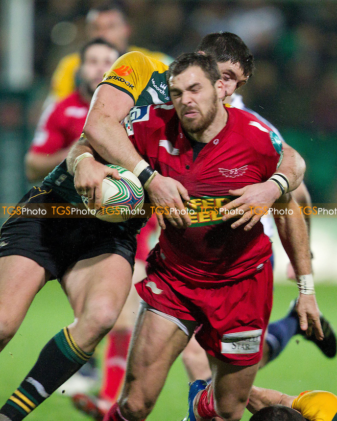 George North of Scarlets RFC is apprehended by Tom Wood of Northampton Saints RFC - Northampton Saints RFC vs Scarlets RFC - Heineken Cup Rugby Pool 1 at Franklin's Gardens - 18/11/11 - MANDATORY CREDIT: Ray Lawrence/TGSPHOTO - Self billing applies where appropriate - 0845 094 6026 - contact@tgsphoto.co.uk - NO UNPAID USE.