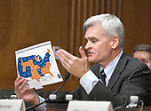 "United States Senator Bill Cassidy (Republican of Louisiana) holds a map showing the ""Current Status of State Medicaid Expansion Decisions"" as he testifies before the US Senate Committee on Finance ""Hearing to Consider the Graham-Cassidy-Heller-Johnson Proposal"" on the repeal and replace of the Affordable Care Act (ACA) also known as ""ObamaCare"" in Washington, DC on Monday, September 25, 2017.  Cassidy, a medical doctor, is one of the authors of the bill.<br /> Credit: Ron Sachs / CNP"