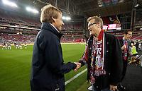 Phoenix, AZ - Saturday, January 21, 2012: Drew Carey and Jurgen Klinsmann talk before the USA Men's national team defeats Venezuela 1-0, at the University of Phoenix Stadium.