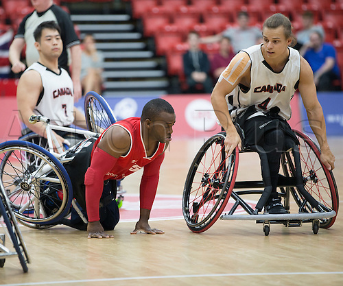 03.07.2016. Leicester Sports Arena, Leicester, England. Continental Clash Wheelchair Basketball, England versus Canada. Ade Orogbemi (GBR) is knocked over during the match