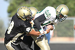 Palos Verdes, CA 10/30/09 - Kyle Nunn (MC# 19) is tackled by Tommy Kim (#8) during the Peninsula-Mira Costa football game.