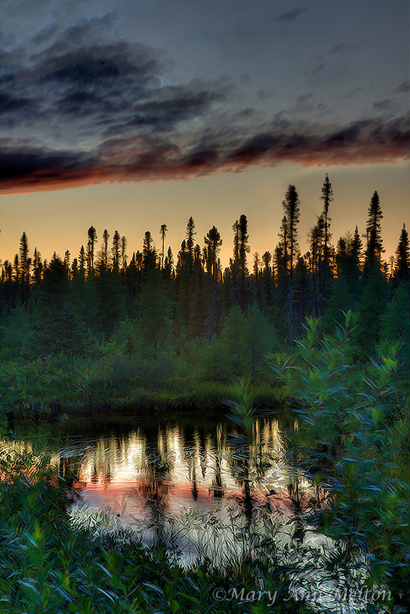 A high dynamic range Fine Arr photo of a sunset view of a glacial lake and the boreal forest