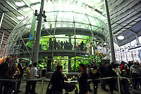 Dec. 30, 2009 - San Francisco, California, USA - Visitors wait in line to get inside a 4-story rainforest at the California California Academy of Sciences Natural History Museum in San Francisco Wednesday December 30, 2009. The giant structure contains many tropical animals including butterflies, snakes, birds and plants. (Photo by Alan Greth)