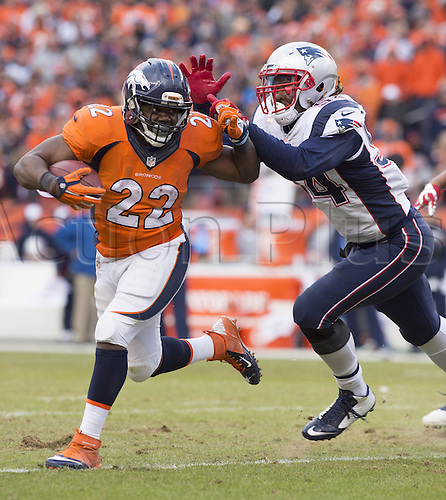 24.01.2016. Denver, Colorado, USA. The NFL AFC Championship American Football match. Broncos running back C.J. Anderson fights off Patriots defender Dont'a Hightower on a run during the fourth quarter of the AFC Championship game on Sunday