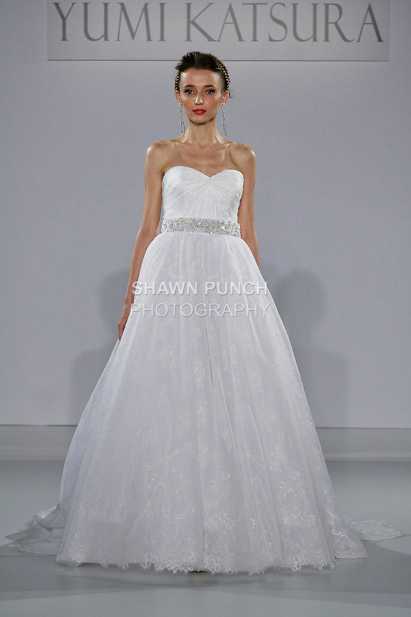 """Model walks runway in a Monaco wedding dress from the Yumi Katsura Fall 2013 """"Painting The World With Beauty"""" bridal collection, during The Couture Show New York Bridal Fashion Week, October 14, 2012."""
