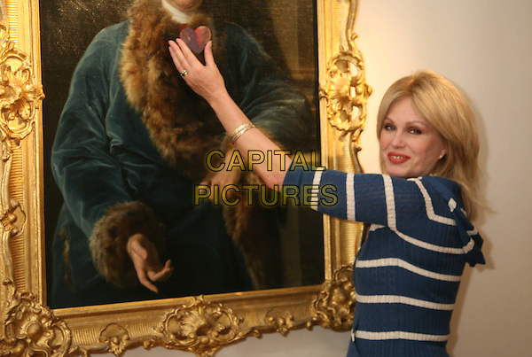JOANNA LUMLEY.adds the first piece to a jigsaw puzzle of John Rolle Walter by Pompeo Batoni.  Pieces of the jigsaw are being sold to visitors at the Olympia International Art & Antiques Fair to raise £15,000 towards the purchase of the painting for the Royal Albert Memorial Museum..London, 4th June 2008..half length blue and white striped cardigan red lipstick hand arm.CAP/DS.©Dudley Smith/Capital Pictures