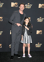 Hugh Jackman &amp; Dafne Keen at the 2017 MTV Movie &amp; TV Awards at the Shrine Auditorium, Los Angeles, USA 07 May  2017<br /> Picture: Paul Smith/Featureflash/SilverHub 0208 004 5359 sales@silverhubmedia.com
