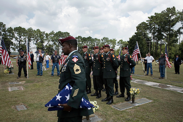 August 26, 2007. Kinston, NC.. A funeral for  Spc. Steven R. Jewell was held at the Pine Lawn Memorial Park in Kinston, NC. Spc. Jewell was killed in a helicopter crash near the Iraqi city of Fallujah on August 14, 2007.. Flags for the members of Spc. Jewell's family are taken to the gravesite.