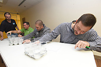 NWA Democrat-Gazette/FLIP PUTTHOFF <br /> WATER TASTING CHAMPIONSHIP<br /> Nathan Miles (seated from left), Matt Walters and Ben Kennedy judge water samples on Wednesday March 13 2019 from Northwest Arkansas water providers during the annual best-tasting water contest in Rogers. Springdale Water Utilities won the contest to reign as 2019 water tasting champions. Water tasting drama unfolded when Springdale and Bella Vista Water Department tied for first. Springale emerged the winner in a sip-off. Tap water was judged on taste, color, clarity and odor, said Zak Johnston (left), contest coordinator with Washington Water Authority.  The contest was held at the Center for Nonprofits in Rogers during the monthly meeting of the Northwest District of the Arkansas Waterworks and Water Environment Association. Springdale water advances to the state water-tasting championship in May during the association's state meeting in Hot Springs.