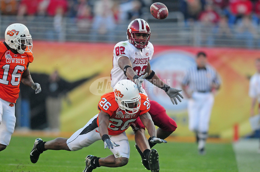 Dec 31, 2007; Tempe, AZ, USA; Oklahoma State Cowboys safety Quinton Moore (26) breaks up a pass intended for Indiana Hoosiers wide receiver James Hardy (82) in the first quarter of the Insight Bowl at Sun Devil Stadium. Mandatory Credit: Mark J. Rebilas-US PRESSWIRE