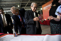 "Visiting dignitaries sign a banner congratulating the Amity Printing Company on the opening of its new press facility in Nanjing, China...On May 18, 2008, the Amity Printing Company in Nanjing, Jiangsu Province, China, inaugurated its new printing facility in southern Nanjing.  The facility doubles the printing capacity of the company, now up to 12 million Bibles produced in a year, making Amity Printing Company the largest producer of Bibles in the world.  The company, in cooperation with the international organization the United Bible Societies, produces Bibles for both domestic Chinese use and international distribution.  The company's Bibles are printed in Chinese and many other languages.  Within China, the Bibles are distributed both to registered and unregistered Christians who worship in illegal ""house churches."""