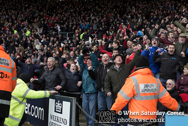 Derby County 1 Nottingham Forest 2, 17/01/2015. iPro Stadium, Championship. Away fans celebrating their team's equalising goal by Britt Assombalonga during the second-half of Derby Country's Championship match against Nottingham Forest at the iPro Stadium, Derby. The match was won by the visitors by 2 goals to 1, watched by a derby-day crowd of 32,705. The stadium, opened in 1997, was formerly known as Pride Park. Photo by Colin McPherson.