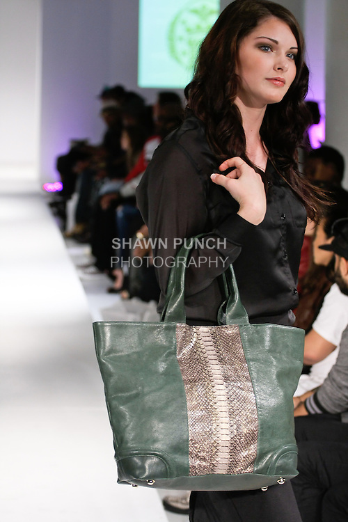 Model walks runway with a handbag from the TORREGROSSA Spring Summer 2013 collection, during BK Fashion Weekend Spring Summer 2013, September 30, 2012.