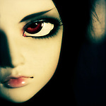 Close up of a sultry dolls face with large brown eyes