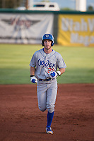 Nick Dean (22) of the Ogden Raptors rounds the bases after hitting a home run against the Orem Owlz in Pioneer League action at Home of the Owlz on June 20, 2015 in Provo, Utah.The Raptors defeated the Owlz 9-6. (Stephen Smith/Four Seam Images)