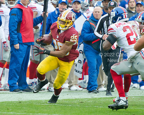 Washington Redskins running back Chris Thompson (25) carries the ball after making a catch in the first quarter against the New York Giants at FedEx Field in Landover, Maryland on Sunday, November 29, 2015. New York Giants cornerback Prince Amukamara (20) pursues on the play.  The Redskins won the game 20-14.<br /> Credit: Ron Sachs / CNP<br /> (RESTRICTION: NO New York or New Jersey Newspapers or newspapers within a 75 mile radius of New York City)
