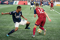 FOXBOROUGH, MA - SEPTEMBER 21: Brandon Bye #15 of New England Revolution tackles Brooks Lennon #12 of Real Salt Lake during a game between Real Salt Lake and New England Revolution at Gillette Stadium on September 21, 2019 in Foxborough, Massachusetts.
