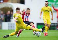 Lincoln City's Jack Payne battles with Fleetwood Town's Harry Souttar<br /> <br /> Photographer Andrew Vaughan/CameraSport<br /> <br /> The EFL Sky Bet League One - Lincoln City v Fleetwood Town - Saturday 31st August 2019 - Sincil Bank - Lincoln<br /> <br /> World Copyright © 2019 CameraSport. All rights reserved. 43 Linden Ave. Countesthorpe. Leicester. England. LE8 5PG - Tel: +44 (0) 116 277 4147 - admin@camerasport.com - www.camerasport.com