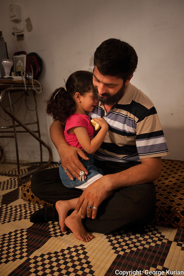 l0/08/20l2 Al Bab:<br /> Reduan, a plumber from Homs is in control of the FSA prison.<br /> He claims one of his two wives and four children were murdered after they were raped.<br /> Reduan's daughter Budur who sustained bullet injuries in the attack cries on hearing her father talk of her brothers and sisters.