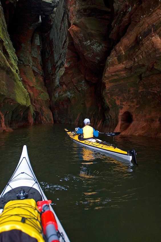 Sea kayakers explore the sea caves at Meyers Beach in the Apostle Islands National Lakeshore near Bayfield Wisconsin.