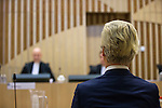 Dutch far-right Party for Freedom (PVV) leader Geert Wilders sits in the courtroom in the courthouse in Schiphol, the Netherlands March 18, 2016. <br /> REUTERS/Michael Kooren