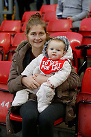 17th November 2019; Anfield, Liverpool, Merseyside, England; Womens Super League Footballl, Liverpool Women versus Everton; Mother and child Liverpool fans on the Kop before the game - Editorial Use