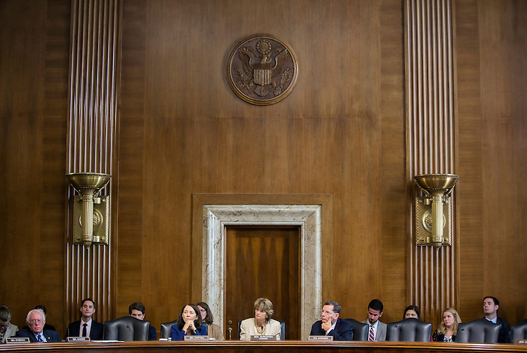 """UNITED STATES - JULY 29: Chairman Lisa Murkowski, R-Alaska, listens as Sen. Elizabeth Warren, D-Mass., proposes an amendment, as she sits beside Sen. Bernie Sanders, D-Vt., far left, Sen. Maria Cantwell, D-Wash., left, and Sen. John Barraso, D-Wy., right, as the Senate Energy and Natural Resources Committee holds a markup of the """"Energy Policy Modernization Act of 2015"""" on Capitol Hill in Washington, July 29, 2015. (Photo By Al Drago/CQ Roll Call)"""