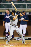 Holt Perdzock #14 (Ole Miss) of the Wilson Tobs at bat against the High Point-Thomasville HiToms at Finch Field on June 17, 2013 in Thomasville, North Carolina.  The Tobs defeated the HiToms 3-2 in 11 innings.  Brian Westerholt/Four Seam Images