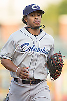 Columbus Clippers shortstop Francisco Lindor (12) jogs off the field between innings of the game against the Charlotte Knights at BB&T BallPark on May 27, 2015 in Charlotte, North Carolina.  The Clippers defeated the Knights 9-3.  (Brian Westerholt/Four Seam Images)