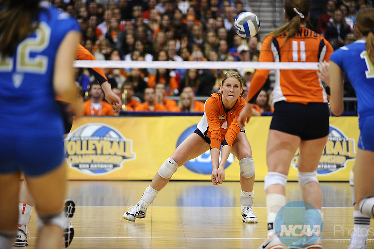 17 DEC 2011: Colleen Ward (04) of Illinois returns service from UCLA during the Division I Women's Volleyball Championship held at the Alamodome in San Antonio, TX. UCLA defeated Illinois 3-1. Joshua Duplechian/NCAA Photos