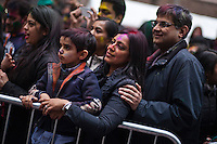 An Indian family attend the Holi Hai festival organized by Indian community in New York City March 31, 2013. Photo by Eduardo Munoz Alvarez / VIEWpress.
