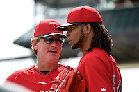 Minnesota Twins pitching coach Neil Allen (41) talks with pitcher Ervin Santana (54) during a Spring Training game against the Pittsburgh Pirates on March 13, 2015 at McKechnie Field in Bradenton, Florida.  Minnesota defeated Pittsburgh 8-3.  (Mike Janes/Four Seam Images)